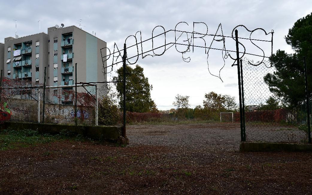 An abandonned soccer field in the Tor Sapienza neighborhood of Rome, where a refugee facility has been repeatedly at the centre of violence (AFP Photo/Alberto Pizzoli)