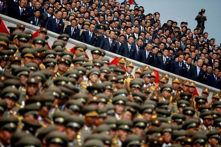 FILE PHOTO: A soldier films North Korean soldiers, officers and high ranking officials attending a military parade marking the 105th birth anniversary of country's founding father Kim Il Sung in Pyongyang, North Korea, April 15, 2017. REUTERS/Damir Sagolj/File Photo