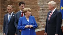 The Latest: Merkel reminds Trump about German investment