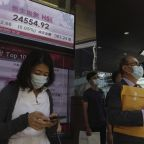 Asian shares mixed as U.S. virus aid hopes fade