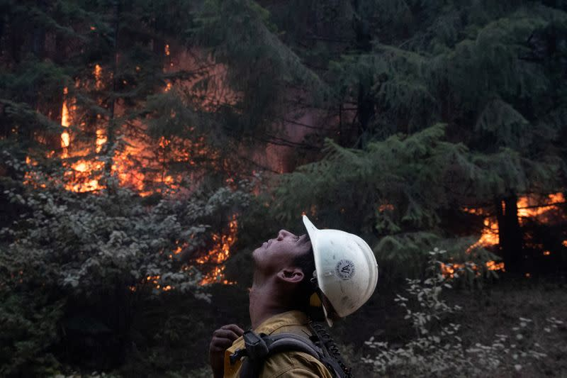 Firefighter monitors ambers from a firing operation near the Obenchain Fire in Butte Falls, Oregon