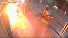 CCTV Captures Arson Attack on Manchester Shop and Motorbike Getaway