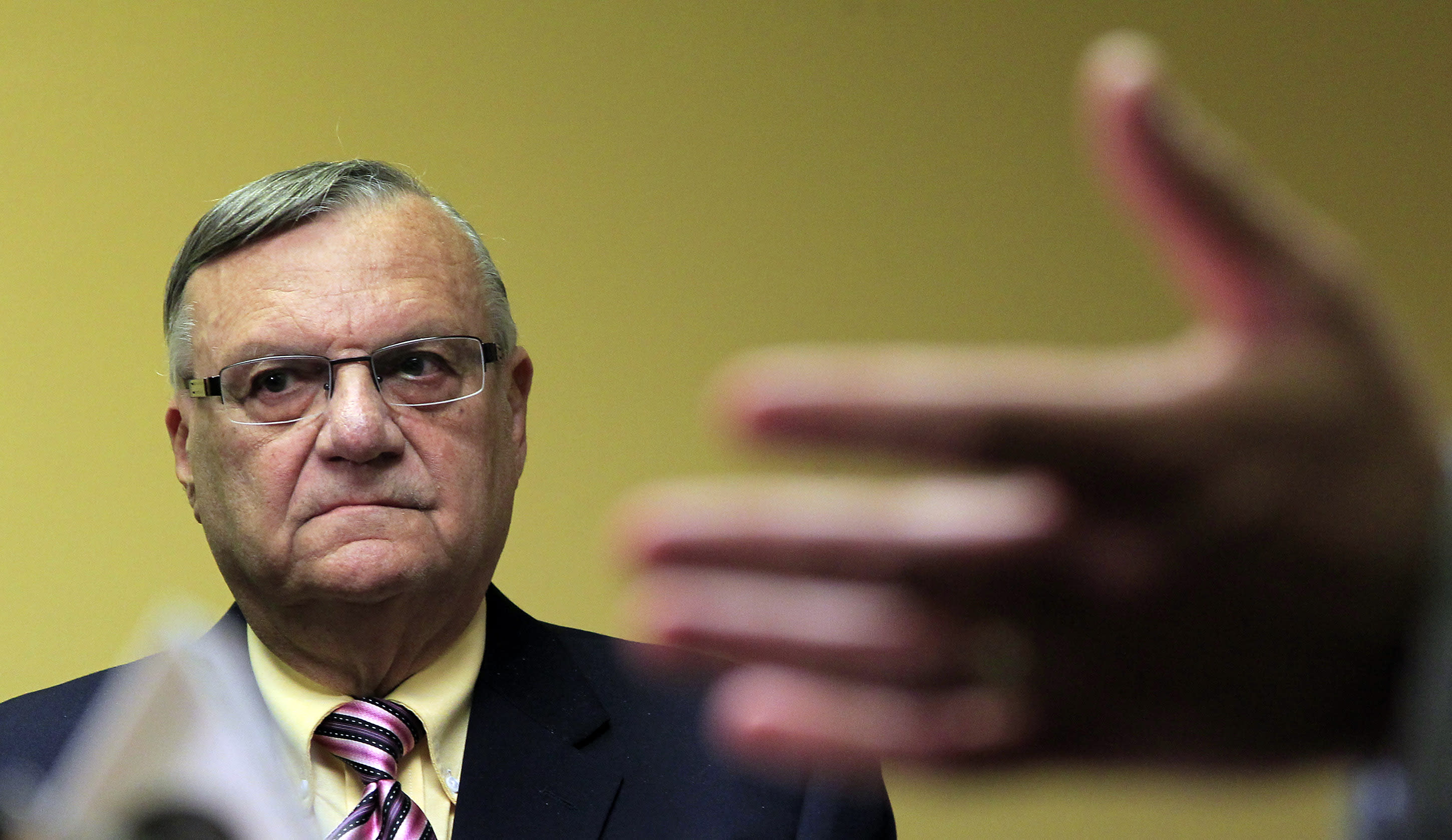 Maricopa County Sheriff Joe Arpaio, listens to one of his attorneys explain the latest developments while holding a news conference after federal authorities announced that the sheriff has negotiated in bad faith and risks ending settlement talks Tuesday, April 3, 2012, in Phoenix.(AP Photo/Ross D. Franklin, file)