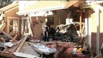 Car Crashes Into Condos, Everyone Escapes Unharmed