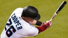 Garrett Cooper dusts off his outfielder's glove