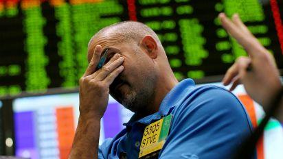 Stocks fall, crude oil plummets 7%