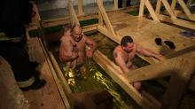 Thousands bathe in icy water on the night of Epiphany