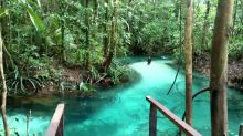 Amazing crystal-clear blue lake hidden away in Indonesian forest
