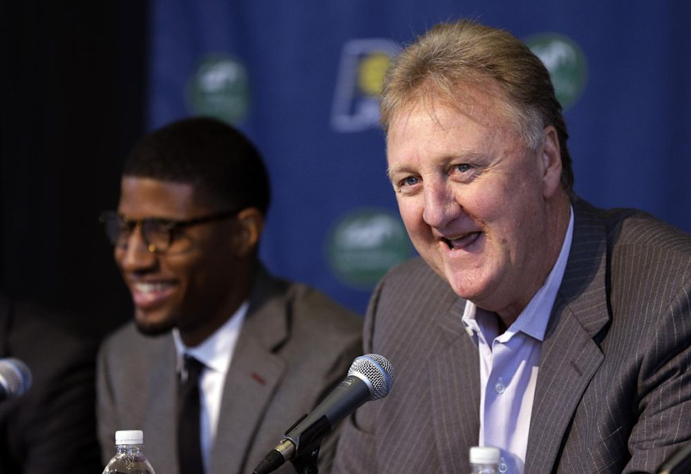 Indiana Pacers forward Paul George, left, laughs as team president Larry Bird talks about signing George to a multi-year contract extension with the NBA basketball team in Indianapolis, Wednesday, Sept. 25, 2013