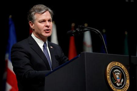 FBI Director Christopher Wray delivers remarks to a graduation ceremony at the FBI Academy on the grounds of Marine Corps Base Quantico in Quantico, Virginia