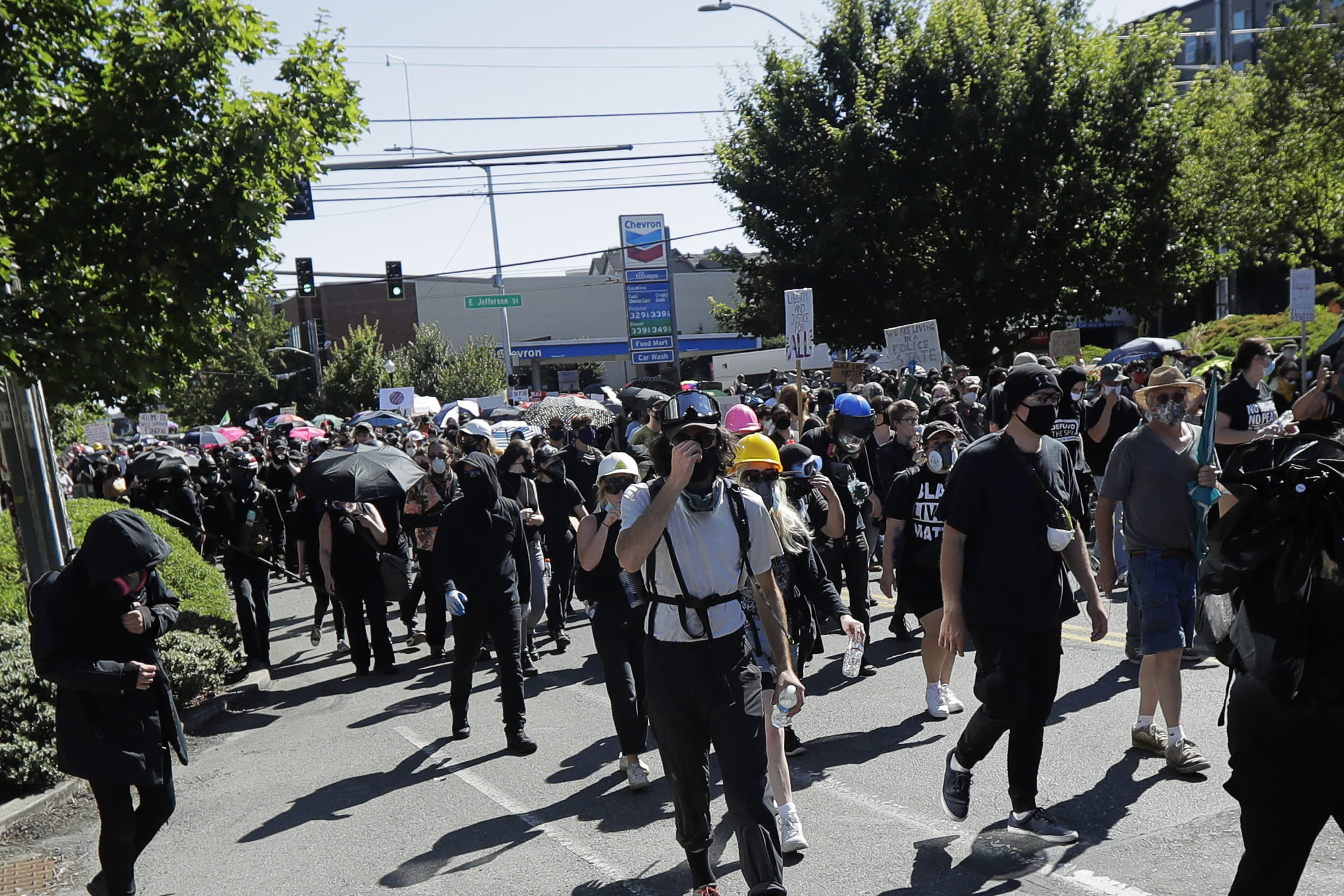 Protesters march near the King County Juvenile Detention Center, Saturday, July 25, 2020, in Seattle, in support of Black Lives Matter and against police brutality and racial injustice. (AP Photo/Ted S. Warren)