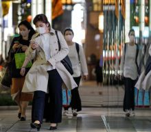 Japan declares 'short, powerful' emergency in Tokyo, elsewhere