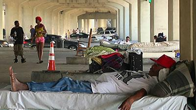 Homeless Under Freeway Told to Leave