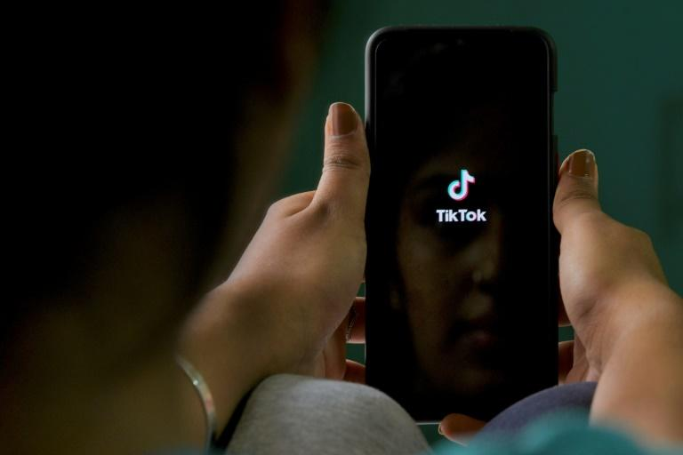 """TikTok defended itself with its general manager for the US, telling users the company was working to give them """"the safest app,"""" amid US concerns over data security (AFP Photo/Manjunath Kiran)"""