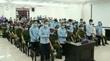 Vietnam sentences brothers to death after violent land clash