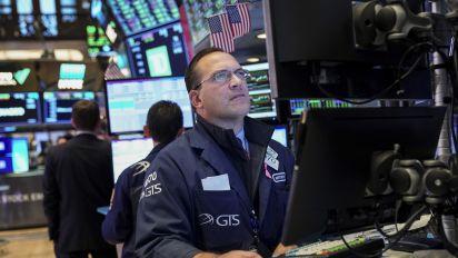 Stocks mixed amid earnings deluge