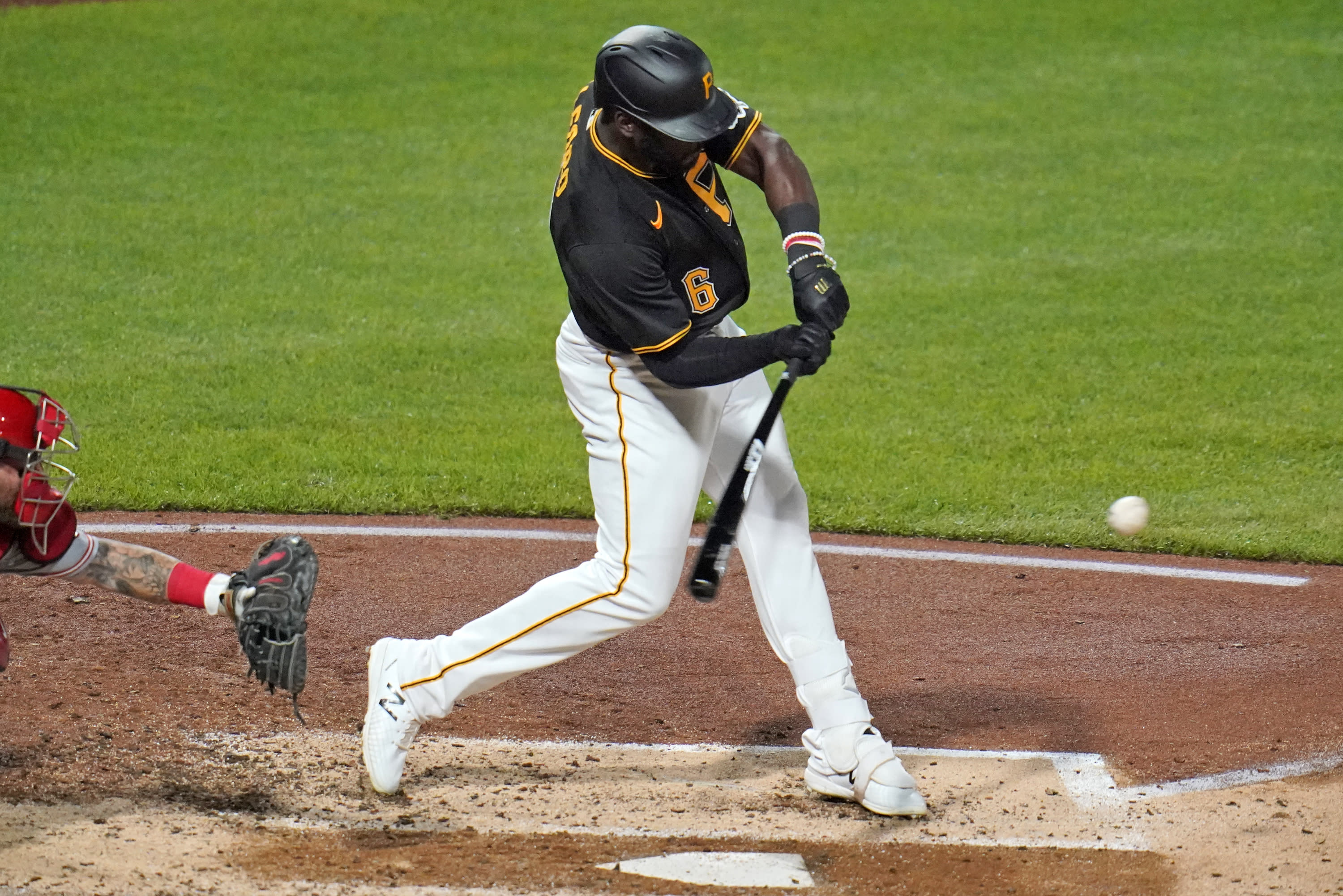 Pittsburgh Pirates' Anthony Alford swings for a triple off Cincinnati Reds starting pitcher Trevor Bauer that drove in two runs during the fourth inning of the second baseball game of a doubleheader in Pittsburgh, Friday, Sept. 4, 2020. (AP Photo/Gene J. Puskar)