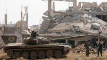 Syria seeks to crush insurgent pocket, denies evacuation deal