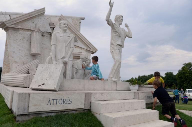 "A monument in Sopron, on the Hungarian border with Austria, commemorates the 1989 ""Pan-European Picnic"" during which at least 600 East Germans crossed the border and escaped to the West (AFP Photo/ATTILA KISBENEDEK)"