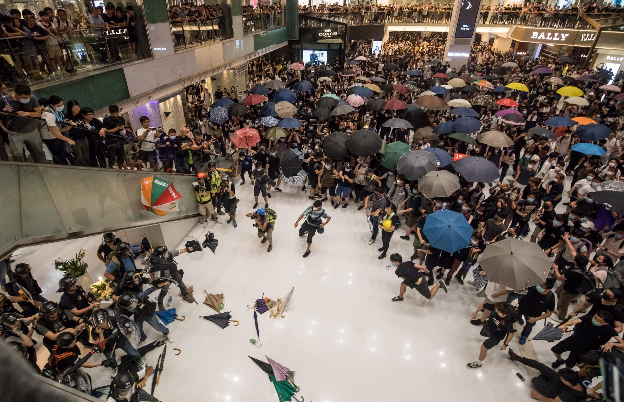 "(Bloomberg) -- Hong Kong police arrested more than 40 people after attempts to clear the remnants of a mass anti-government march resulted in dramatic clashes with demonstrators inside a suburban shopping mall, piling more pressure on embattled leader Carrie Lam.Scuffles broke out in New Town Plaza as police moved to clear stragglers from a rally earlier Sunday in Sha Tin, a popular destination for locals and visitors from China and home to one of the city's horse racing tracks. Rally organizers said 110,000 people had turned out to protest the city's chief executive and her controversial bid to allow extraditions to the mainland, while police estimated the crowd at 28,000.The unrest came as the Financial Times reported that Lam had offered to resign in recent weeks, only to be refused by authorities in China, citing unidentified people familiar with the matter. Beijing insisted that she remain in office to fix ""the mess she created,"" according to one person.Lam on Monday vowed she would continue in her position as Hong Kong's leader.""The chief executive's tenure is five years. Although I face a lot of difficulties, I have repeatedly said publicly that I still have the responsibility and enthusiasm to continue my work during my tenure,"" she told reporters at a hospital after visiting officers injured in the clashes.New MessageCrowds of Hong Kong protesters have turned out in unprecedented sizes every week since mid-June. In recent days their ire has focused on China, which has ruled the former British colony since 1997. Thousands of demonstrators last Sunday walked through the Tsim Sha Tsui area popular with mainland tourists toward the city's new high-speed rail station to China.Beijing has continued to back Lam publicly. Chinese Foreign Ministry spokesman Geng Shuang said Monday that he hadn't heard anything about the FT's report and that the central government ""firmly supports"" her leadership. Sunday's protesters threw objects including umbrellas, water bottles and other objects at police, some from the floors above as officers tried to disperse the crowd, Radio Television Hong Kong reported. Lam on Monday referred to those who attacked police as ""rioters,"" a term that has angered protesters because it carries certain legal connotations. Security chief John Lee called the incidents an escalation of violence and said the demonstrators who attacked police were ""well organized.""Ten officers were injured, including at least one who lost a finger, in fights between riot police and umbrella-wielding protesters Sunday evening, Police Commissioner Stephen Lo said in a 2:30 a.m. briefing Monday. One protester suspected of biting off part of an officer's finger was among those arrested, he said.Twenty-two demonstrators were also injured at the mall, RTHK reported, citing the city's hospital authority. Three were in serious condition, it said. The mall is owned by Sun Hung Kai Properties Ltd.Hong Kong's Demonstrators Get Creative With War of the WallsOpposition lawmaker Alvin Yeung held a late-night media briefing in the mall, saying the police hadn't let protesters leave safely. The mere presence of the riot officers could have triggered demonstrators' emotions and made them nervous, he said.""If we are aware of illegal behavior and if we know those who breached the law are in the mall, then don't we have a responsibility to follow inside to make arrests?"" Lo said in response a question early Monday.How China Can Recover Even If Hong Kong's Lam Quits: QuickTakeLam last week declared that the original cause of the protests -- the extradition bill -- was ""dead."" But she stopped short of officially withdrawing it, leaving open the potential for authorities to revive it with 12 days' notice and providing new momentum for protesters.Further protests are being planned in neighborhoods across the city by demonstrators organizing themselves online and vowing to spread the word until Lam responds to their demands.On Saturday, scuffles also broke out between police and demonstrators after a rally against parallel traders ended in Sheung Shui, near the China border. More than 30,000 people took part in the largely peaceful march, according to North District Parallel Imports Concern Group convener Ronald Leung. Police estimated the turnout at 4,000.The Civil Human Rights Front, a leading protest organizer, has called for a July 21 rally in Admiralty, ground zero for previous gatherings that brought out historic crowds. Its major demand will be an independent probe into what it calls excessive use of force by police in dispersing previous demonstrations with weapons including tear gas, batons and rubber bullets.Lam needs to get a grasp on protesters' grievances and respond to their appeals, the group said Monday.""Otherwise, this campaign will eventually cause irreparable deaths due to the ongoing conflict between the police and the people,"" it said.(Updates with Carrie Lam comment in fourth paragraph.)\--With assistance from Gloria Cheung, Reinie Booysen, Stanley James, Kari Lindberg, Will Davies, Shamim Adam, Fion Li, Dominic Lau, Alfred Liu and Aibing Guo.To contact the reporters on this story: Natalie Lung in Hong Kong at flung6@bloomberg.net;Stephen Tan in Hong Kong at ztan39@bloomberg.netTo contact the editors responsible for this story: Brendan Scott at bscott66@bloomberg.net, Karen LeighFor more articles like this, please visit us at bloomberg.com©2019 Bloomberg L.P."