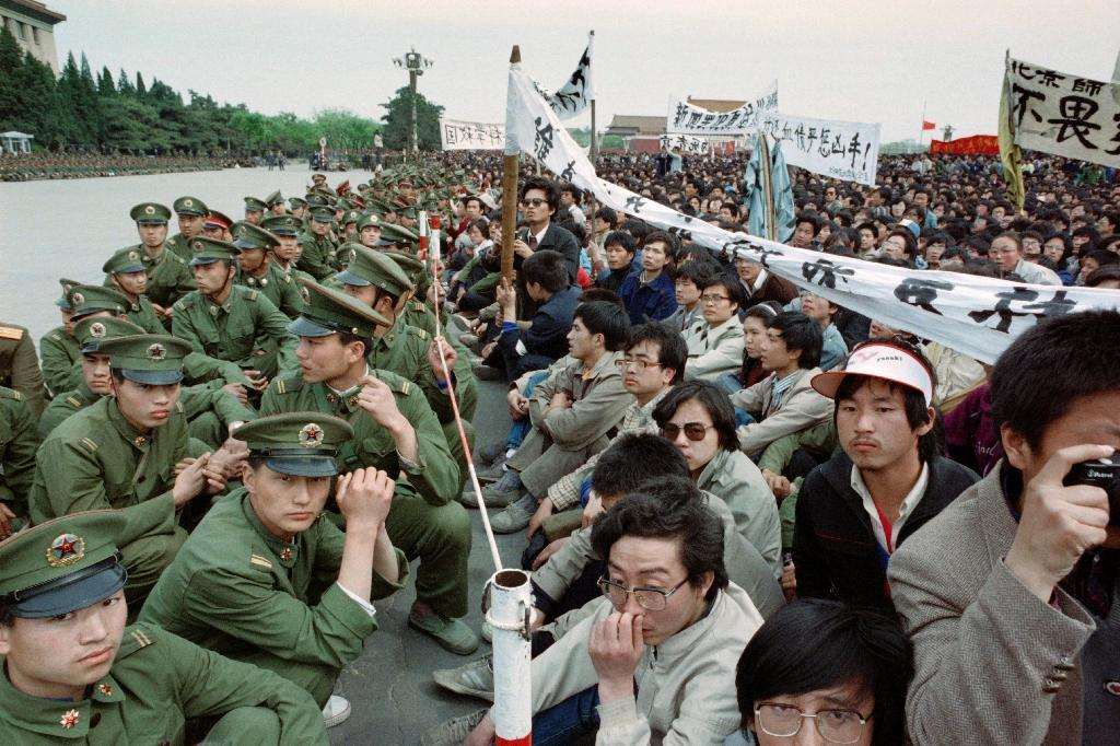 Pro-democracy student protesters come face to face with police outside the Great Hall of the People in Tiananmen Square in April 1989 in Beijing (AFP Photo/CATHERINE HENRIETTE)