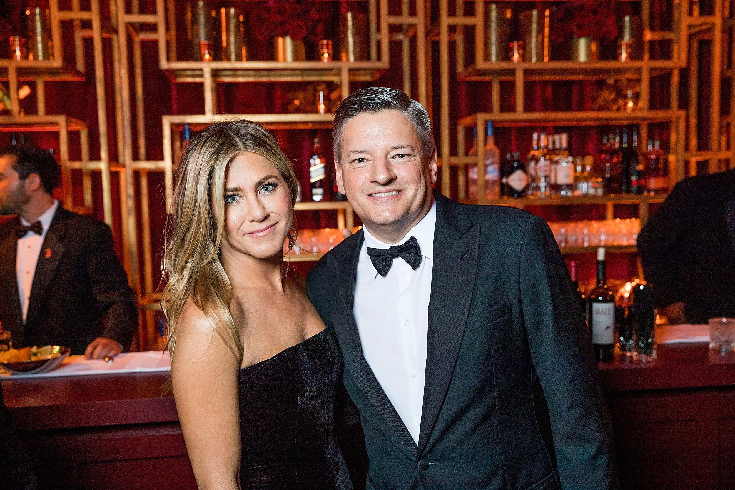 BEVERLY HILLS, CA - JANUARY 07: In this handout photo provided by Netflix,  Jennifer Aniston and Netflix Chief Content Officer, Ted Sarandos attend the Netflix Golden Globes after party at Waldorf Astoria Beverly Hills on January 7, 2018 in Beverly Hills, California.  (Photo by Netflix via Getty Images)