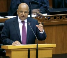 South Africa's Gordhan ordered home from London ahead of Gupta court case