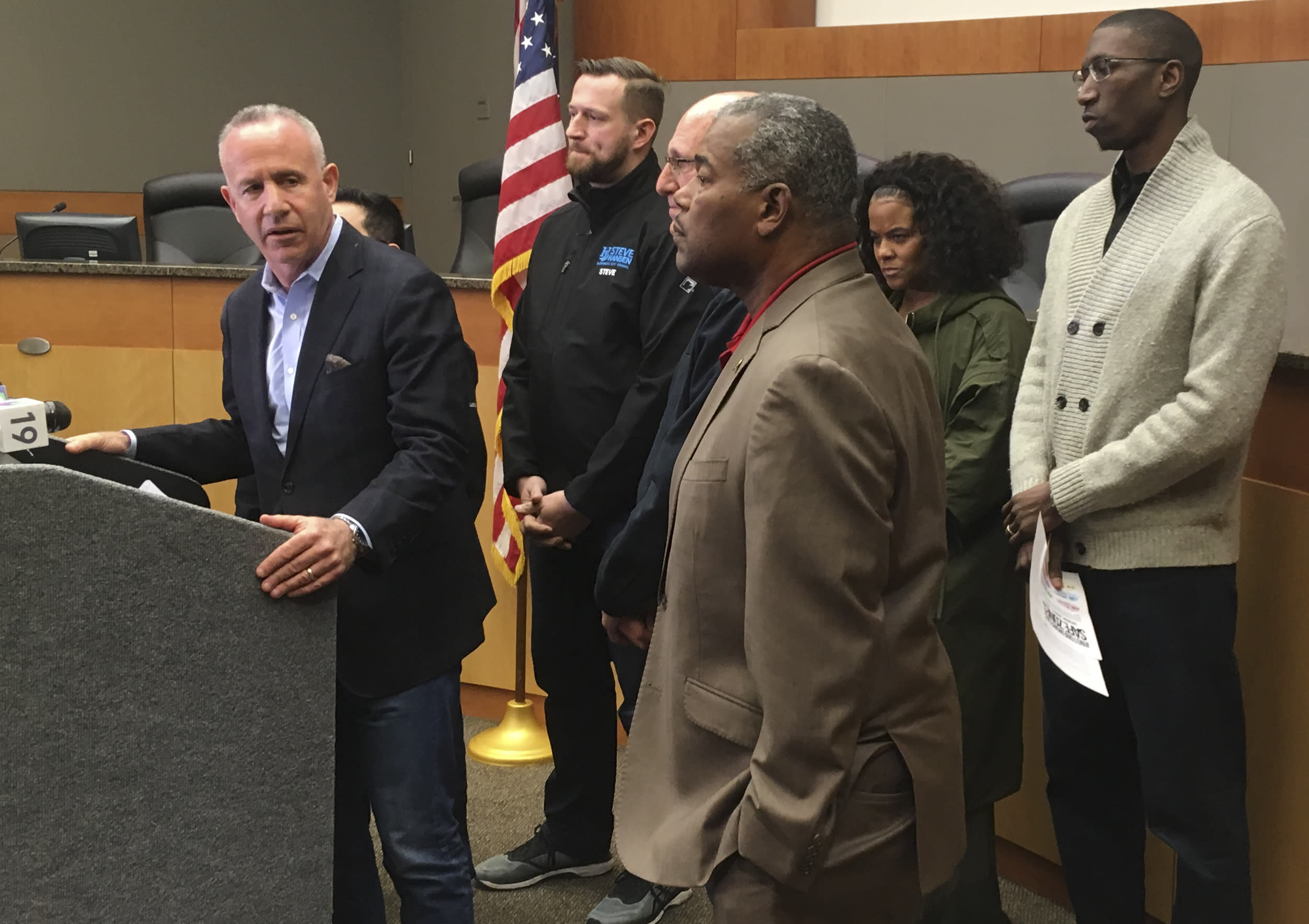 In this March 2, 2019 photo Sacramento Mayor Darrell Steinberg apologizes at City Hall, for Sacramento police officers' fatal shooting of 22-year-old Stephon Clark nearly a year ago after they erroneously thought the black vandalism suspect was pointing a gun. He's backed by city council members and pastors advocating peaceful change. Steinberg is among a growing number of officials saying California should toughen its legal standard for when officers can use deadly force. (AP Photo/Don Thompson)