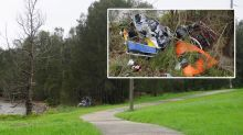 'Disgraceful': Man slams dumpers after huge pile of rubbish left next to walking track