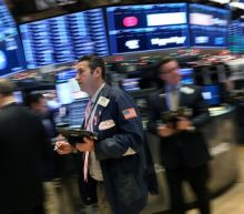 Wall St. tumbles on global growth worries, J&J decline