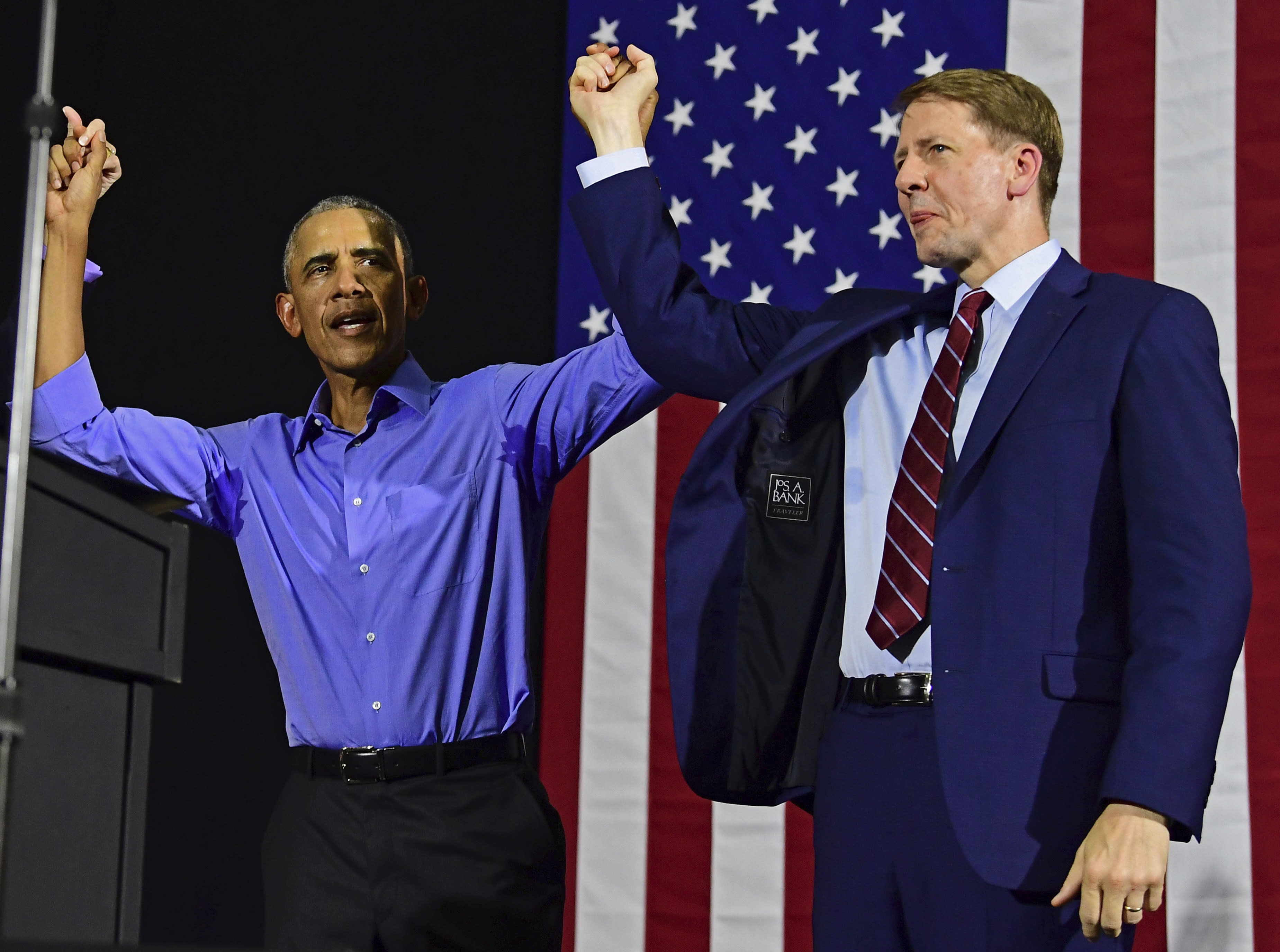 Former President Barack Obama, left, and Democratic gubernatorial candidate Richard Cordray at a campaign rally, Thursday, Sept. 13, 2018, in Cleveland. Former President Barack Obama was in closely divided Ohio to campaign for Democratic gubernatorial candidate Richard Cordray, running mate Betty Sutton, U.S. Sen. Sherrod Brown and the party's statewide slate. (AP Photo/David Dermer)