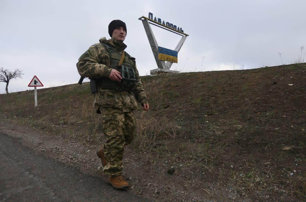 A Ukrainian serviceman patrols on the outskirts of the village of Pavlopil, in the Donetsk region (AFP Photo/Aleksey Filippov)