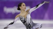 The Latest: Russian figure skaters vying for Olympic gold