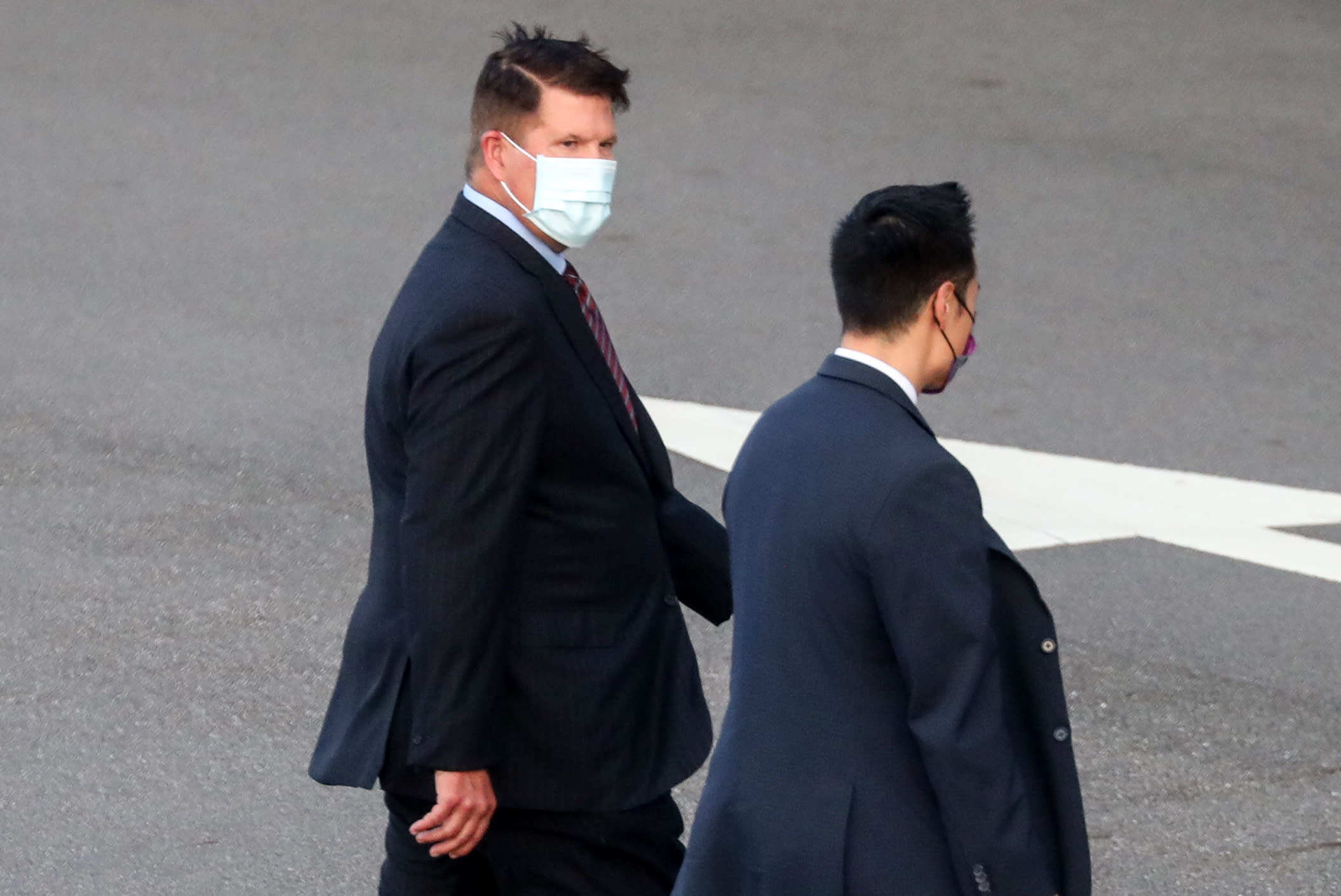 FILE - In this Sept. 17, 2020, file photo, U.S. Undersecretary of State Keith Krach, walks away after disembarking from a plane upon arrival at an airforce base in Taipei. Taiwan. The second U.S. high level envoy to visit Taiwan in two months began a day of closed-door meetings Friday, as China conducted military drills near the Taiwan Strait after threatening retaliation. (Pool Photo via AP Photo, File)