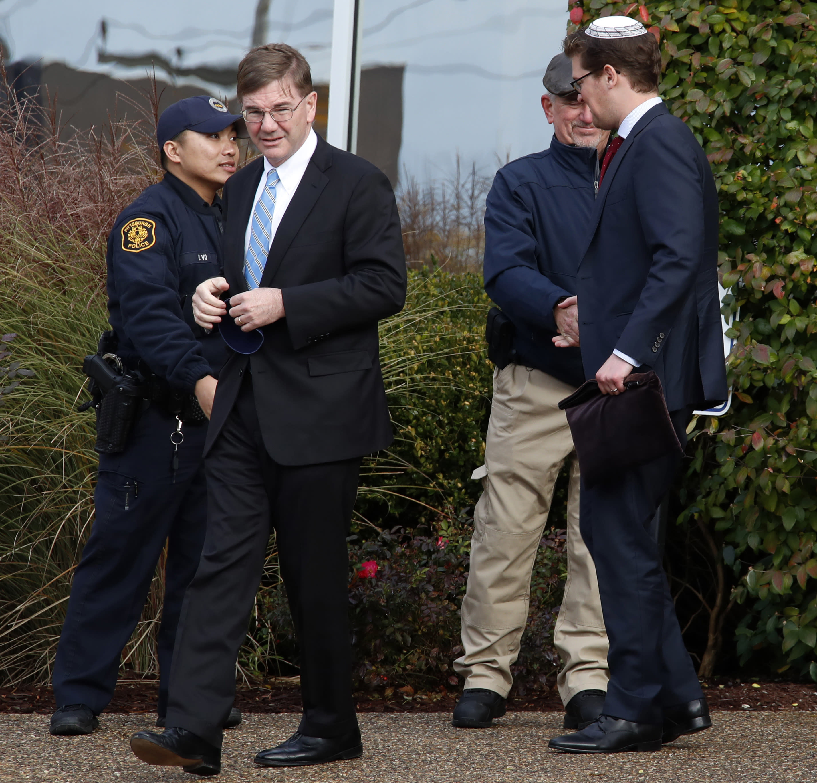 Republican Rep. Keith Rothfus, second from left, leaves the Beth Shalom synagogue after a Shabbat morning service, Saturday, Nov. 3, 2018 in Pittsburgh. (AP Photo/Gene J. Puskar)