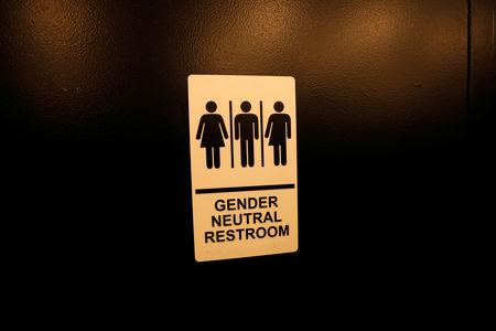 FILE PHOTO - A sign is seen on a gender neutral restroom wall in New York City, U.S., April 19, 2017. REUTERS/Mike Segar