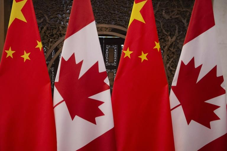 This file photo from December 5, 2017, shows Canadian and Chinese flags prior to a Beijing meeting between the countries' leaders; since then relations have soured, most recently over a new Chinese security law for Hong Kong
