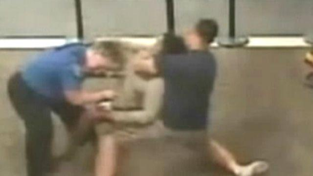 Airport takedown: Off-duty cop subdues unruly woman