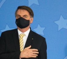 Brazil's Bolsonaro accepts little blame for his country's COVID-19 disaster, but he wears a face mask