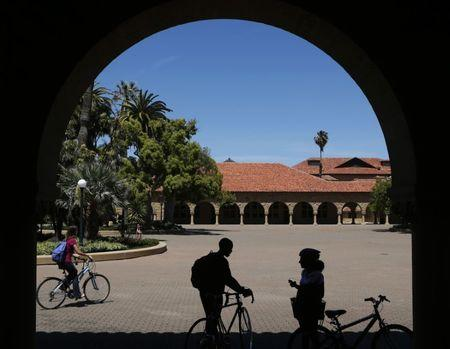 Students retrieve their bicycles after leaving a class, at the Main Quad at Stanford University in Stanford