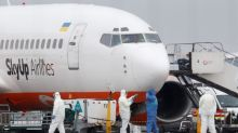Fearing infection, residents protest coronavirus evacuees landing in Ukraine