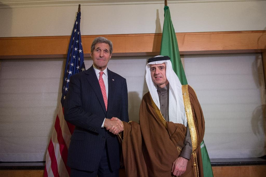 Secretary of State John Kerry meets with Saudi Arabia's Foreign Minister Adel bin Ahmed Al-Jubeir at the New York Palace Hotel in New York on December 17, 2015 (AFP Photo/Bryan Smith)