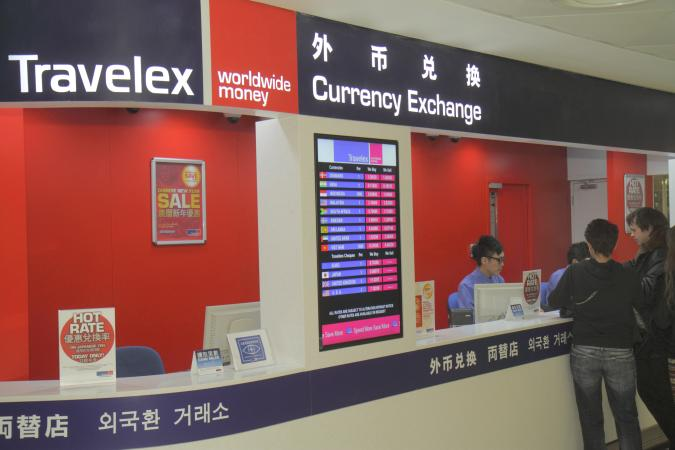 Travelex, currency exchange desk at Hong Kong International Airport. (Photo by: Jeff Greenberg/Universal Images Group via Getty Images)