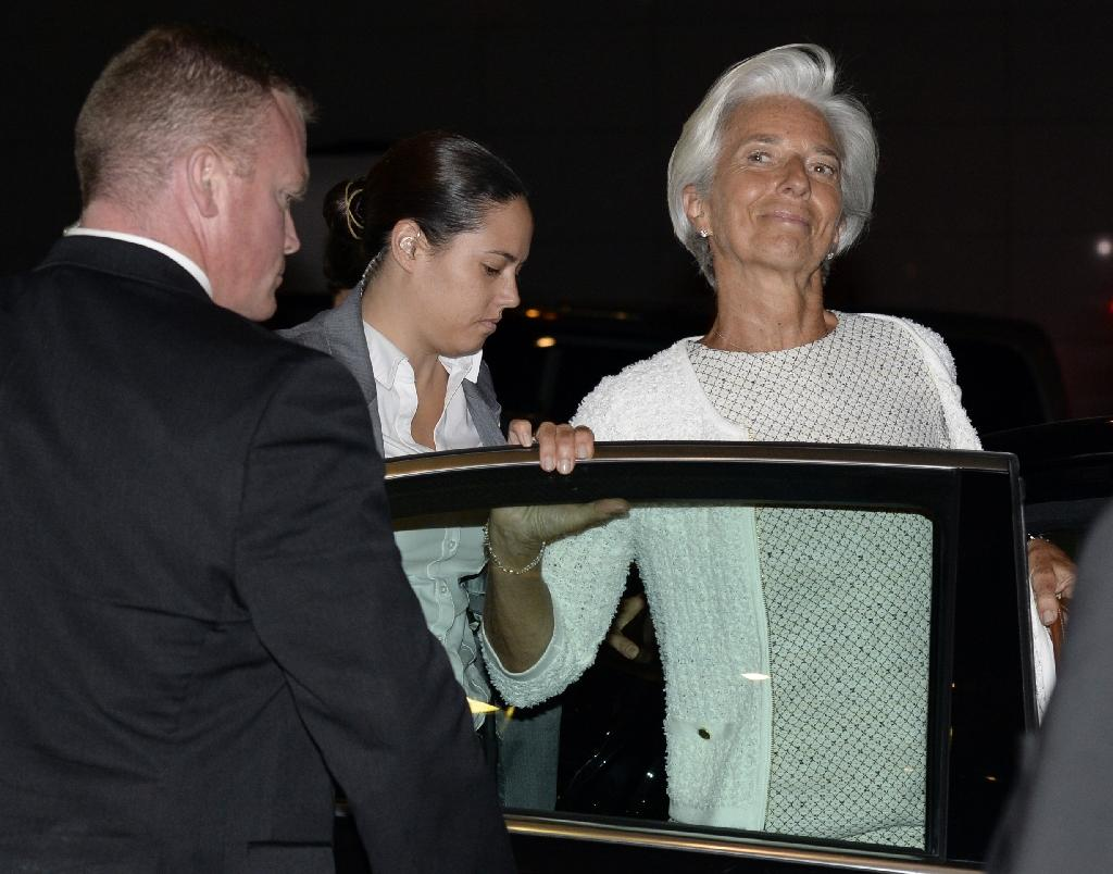 International Monetary Fund (IMF) Managing Director Christine Lagarde leaves a Eurogroup meeting discussing the Greek crisis in Brussels early on July 12, 2015 (AFP Photo/Thierry Charlier)