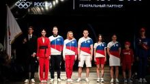 Russia's flag banned but national colors on Olympic uniforms