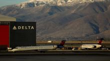 Delta, United profit beats encourage sector, but shutdown impact looms