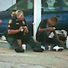Heartwarming: Policewoman Buys Homeless Man Breakfast And Sits On Kerb To Eat With Him