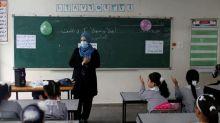 Children walk back to school in Gaza after five-month shutdown