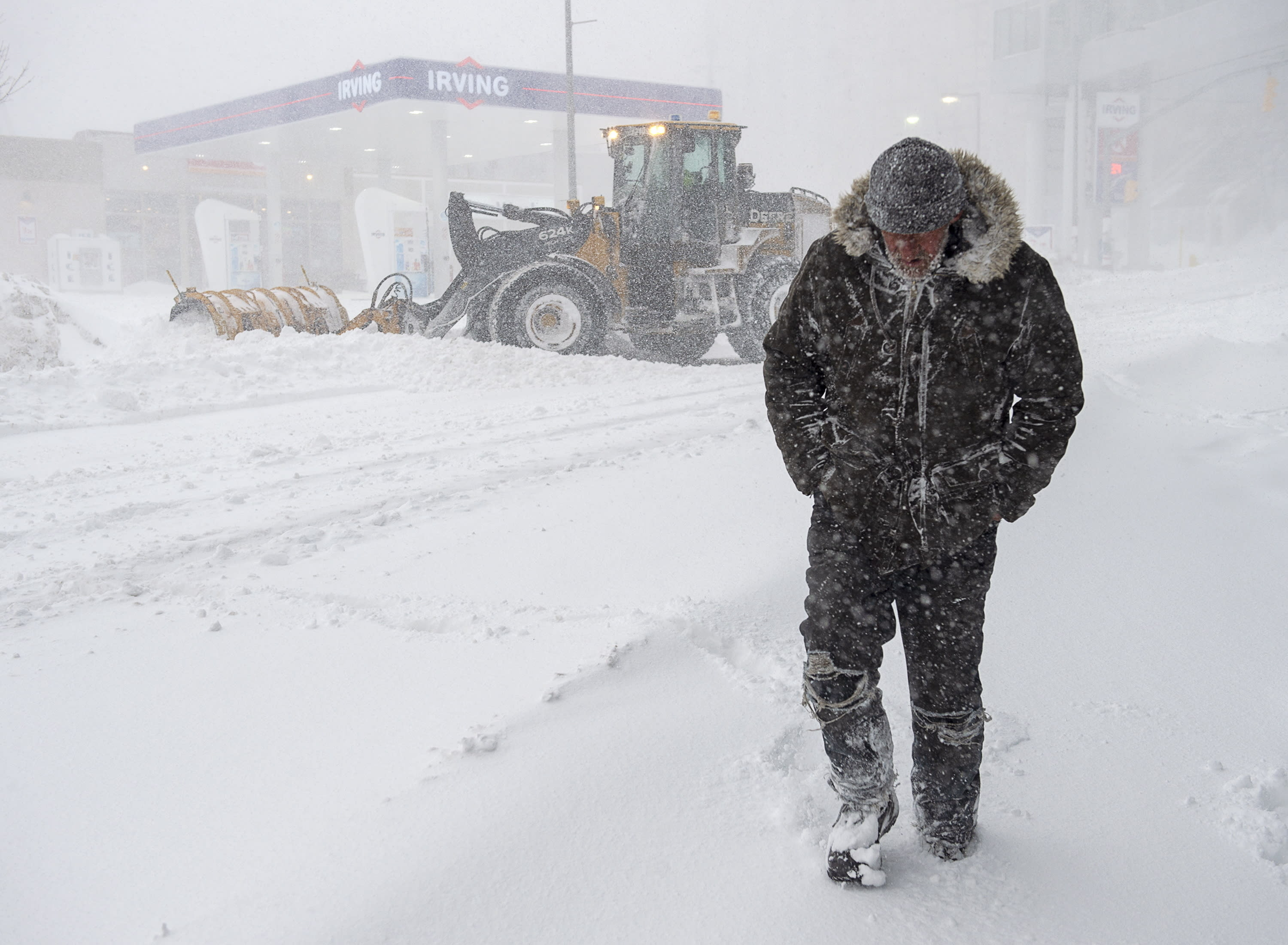 A pedestrian walks through heavy snow in St. John' Newfoundland on Friday, Jan. 17, 2020. The city has declared a state of emergency, ordering businesses closed and vehicles off the roads as blizzard conditions descend on the Newfoundland and Labrador capital. *Andrew Vaughan/The Canadian Press via AP)