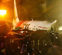 Air India Express plane skids off runway in heavy rains, killing 18 people